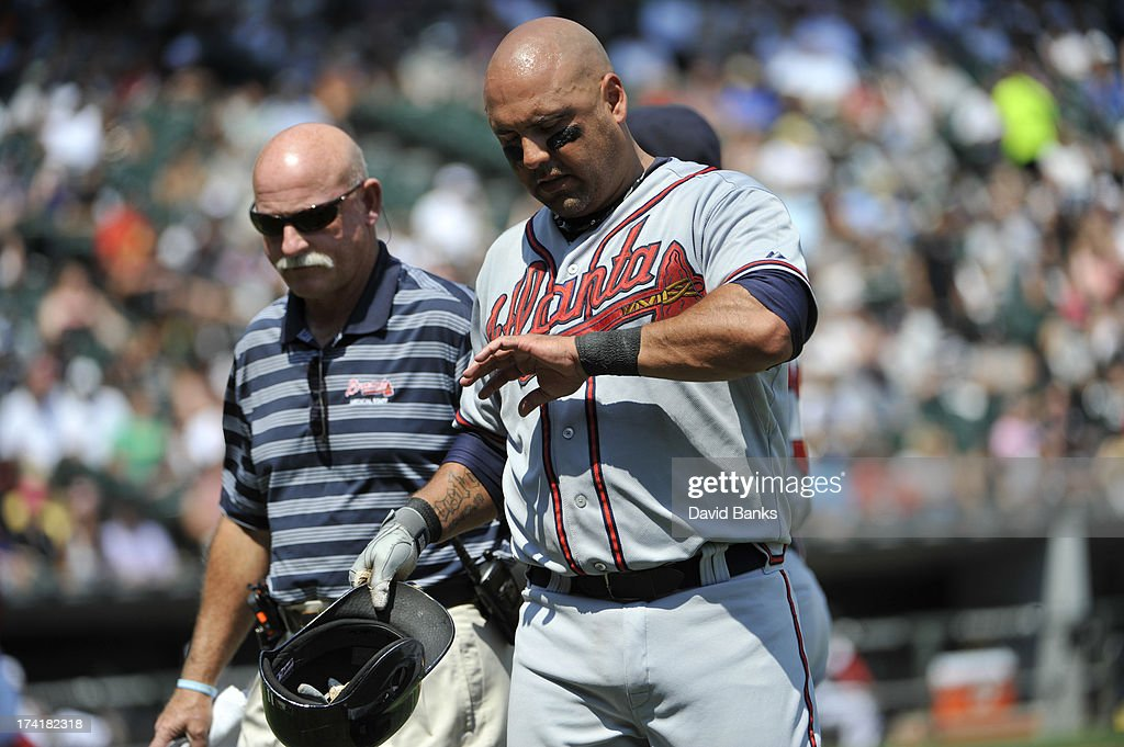 <a gi-track='captionPersonalityLinkClicked' href=/galleries/search?phrase=Gerald+Laird&family=editorial&specificpeople=228949 ng-click='$event.stopPropagation()'>Gerald Laird</a> #11 of the Atlanta Braves leaves the game after being hit by a pitch during the fourth inning against the Chicago White Sox on July 21, 2013 at U.S. Cellular Field in Chicago, Illinois.