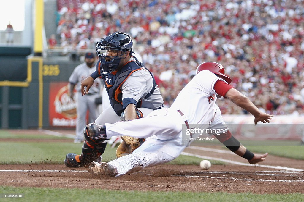 <a gi-track='captionPersonalityLinkClicked' href=/galleries/search?phrase=Gerald+Laird&family=editorial&specificpeople=228949 ng-click='$event.stopPropagation()'>Gerald Laird</a> #9 of the Detroit Tigers loses the ball at homeplate allowing <a gi-track='captionPersonalityLinkClicked' href=/galleries/search?phrase=Zack+Cozart&family=editorial&specificpeople=6889199 ng-click='$event.stopPropagation()'>Zack Cozart</a> #2 of the Cincinnati Reds to score during their game at Great American Ball Park on June 8, 2012 in Cincinnati, Ohio.