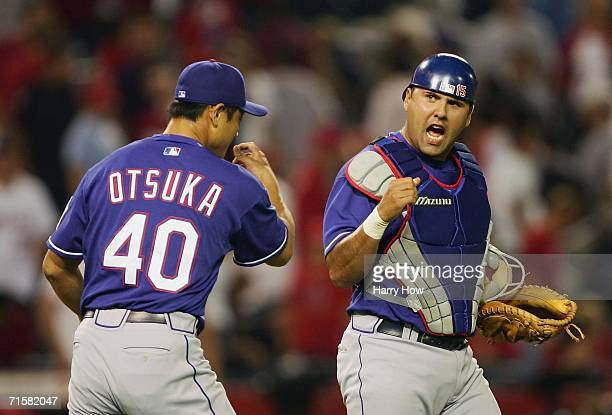 Gerald Laird of the Texas Rangers celebrates a 76 win with Akinori Otsuka against the Los Angeles Angels during the 12th inning at Angel Stadium on...