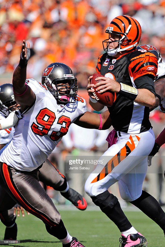 <a gi-track='captionPersonalityLinkClicked' href=/galleries/search?phrase=Gerald+McCoy&family=editorial&specificpeople=4524085 ng-click='$event.stopPropagation()'>Gerald McCoy</a> #93 of the Tampa Bay Buccaneers puts pressure on quarterback <a gi-track='captionPersonalityLinkClicked' href=/galleries/search?phrase=Carson+Palmer&family=editorial&specificpeople=202556 ng-click='$event.stopPropagation()'>Carson Palmer</a> #9 of the Cincinnati Bengals at Paul Brown Stadium on October 10, 2010 in Cincinnati, Ohio.