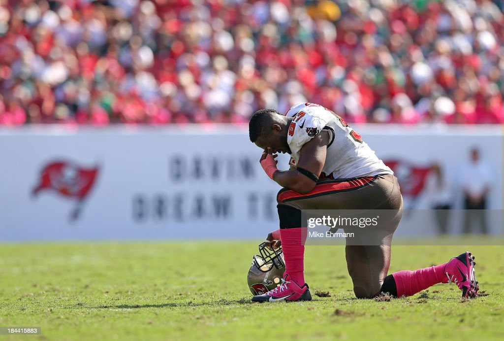 <a gi-track='captionPersonalityLinkClicked' href=/galleries/search?phrase=Gerald+McCoy&family=editorial&specificpeople=4524085 ng-click='$event.stopPropagation()'>Gerald McCoy</a> #93 of the Tampa Bay Buccaneers takes a knee during a game against the Philadelphia Eagles at Raymond James Stadium on October 13, 2013 in Tampa, Florida.