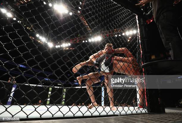 Gerald Meerschaert takes down Thiago Santos of Brazil in their middleweight bout during the UFC 213 event at TMobile Arena on July 8 2017 in Las...