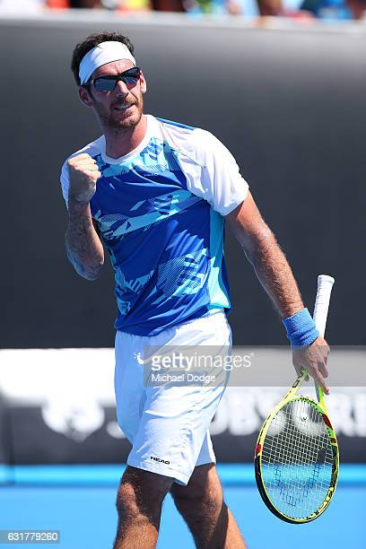 Gerald Melzer of Austria celebrates a point in his first round match against Alex De Minaur of Australia on day one of the 2017 Australian Open at...