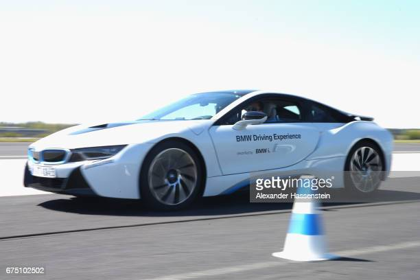 Gerald Melzer of Austria drives a BMW i8 at the BMW DrivingExperience during the BMW driving academy Maisach ahead of the 102 BMW Open by FWU at...