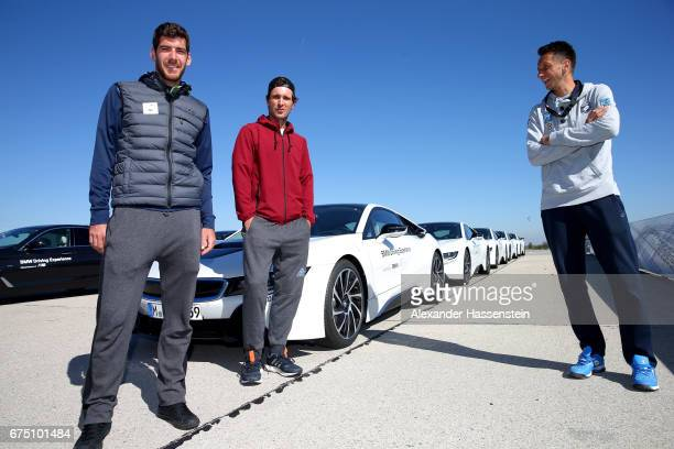 Gerald Melzer of Austria Mischa Zverev of Germany and Sergiy Stakhovsky of Ukraine arrive at the BMW DrivingExperience at BMW driving academy Maisach...