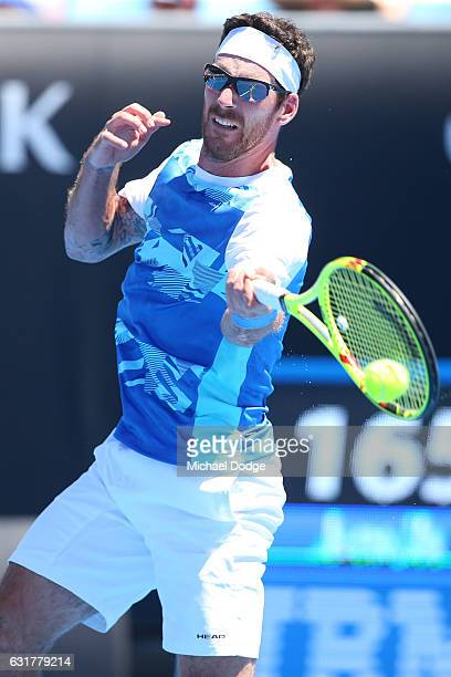 Gerald Melzer of Austria plays a forehand in his first round match against Alex De Minaur of Australia on day one of the 2017 Australian Open at...