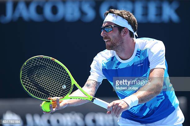 Gerald Melzer of Austria serves in his first round match against Alex De Minaur of Australia on day one of the 2017 Australian Open at Melbourne Park...