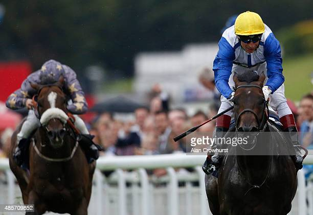 Gerald Mosse riding Kodi Bear win The Doom Bar Celebration Mile at Goodwood racecourse on August 29 2015 in Chichester England