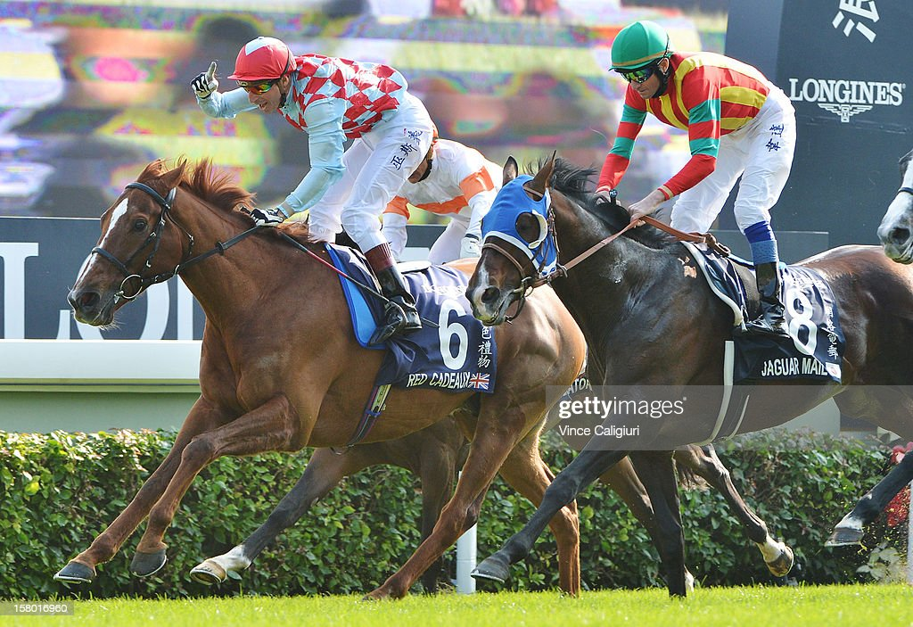 <a gi-track='captionPersonalityLinkClicked' href=/galleries/search?phrase=Gerald+Mosse&family=editorial&specificpeople=2444981 ng-click='$event.stopPropagation()'>Gerald Mosse</a> riding Red Cadeaux celebrates on the line after defeating Douglas Whyte riding Jaguar Mail in The Longines Hong Kong Vase during the Hong Kong International Races at Sha Tin racecourse on December 9, 2012 in Hong Kong.