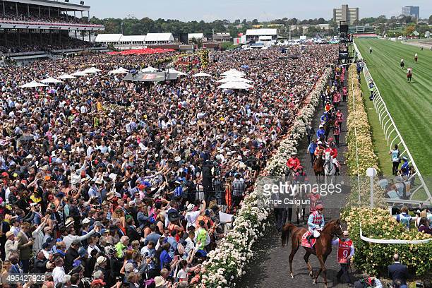 Gerald Mosse riding Red Cadeaux onto the track in front of huge crowd before race 7 the Emirates Melbourne Cup on Melbourne Cup Day at Flemington...