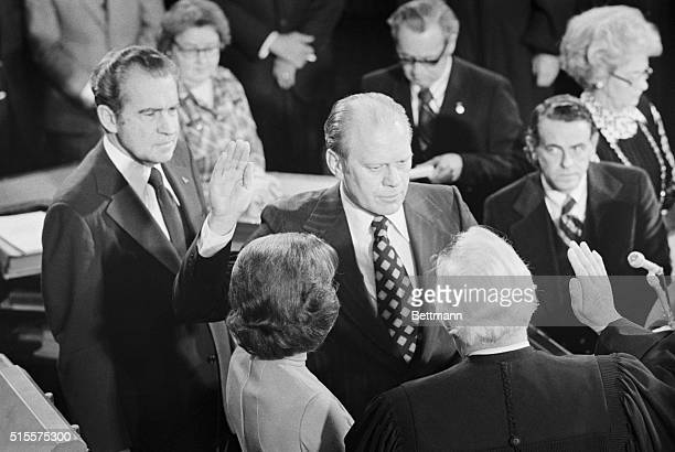 Gerald R Ford is sworn in as the 40th Vice President of the United States in ceremonies in the House chamber 12/6 Left to right President Nixon Mrs...