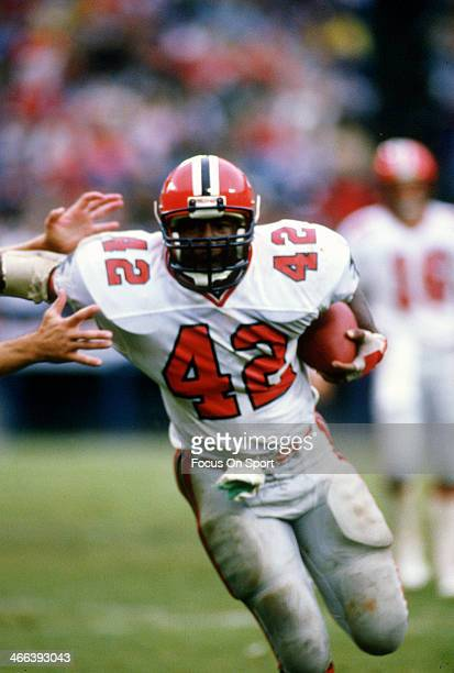 Gerald Riggs of the Atlanta Falcons carries the ball against the Los Angeles Rams during an NFL football game circa 1984 at Anaheim Stadium in...