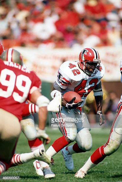 Gerald Riggs of the Atlanta Falcons carries the ball against the San Francisco 49ers during an NFL football game circa 1984 at Candlestick Park in...
