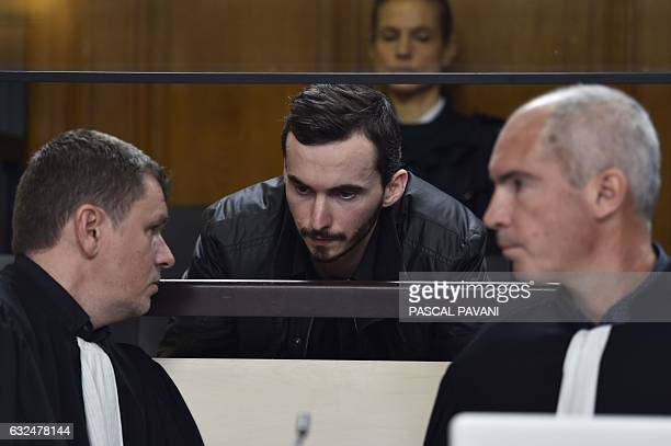 Gerald Seureau accused of the rape and murder of 17yearold Lea in 2011 speaks with his lawyers Luc Abratkiewicz and Jean Marc Darrigade prior to the...