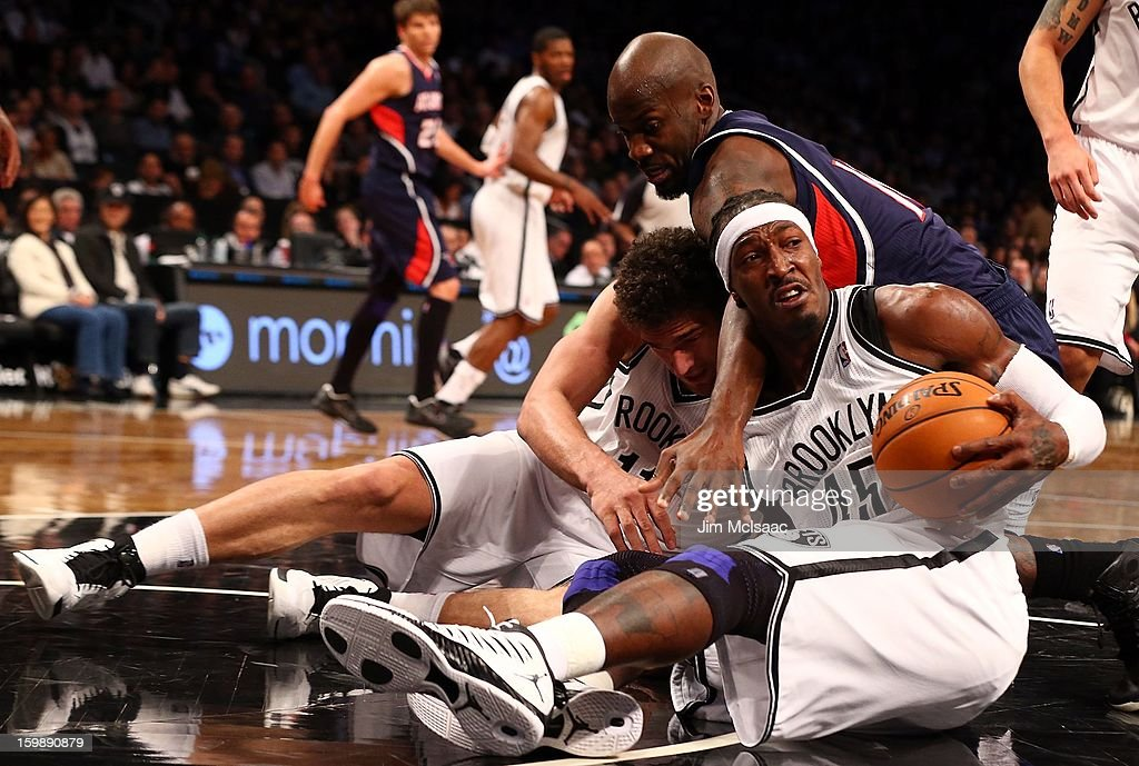 Gerald Wallace #45 and Brook Lopez #11 of the Brooklyn Nets in action against Johan Petro #10 of the Atlanta Hawks at Barclays Center on January 18, 2013 in the Brooklyn borough of New York City.The Nets defeated the Hawks 94-89.
