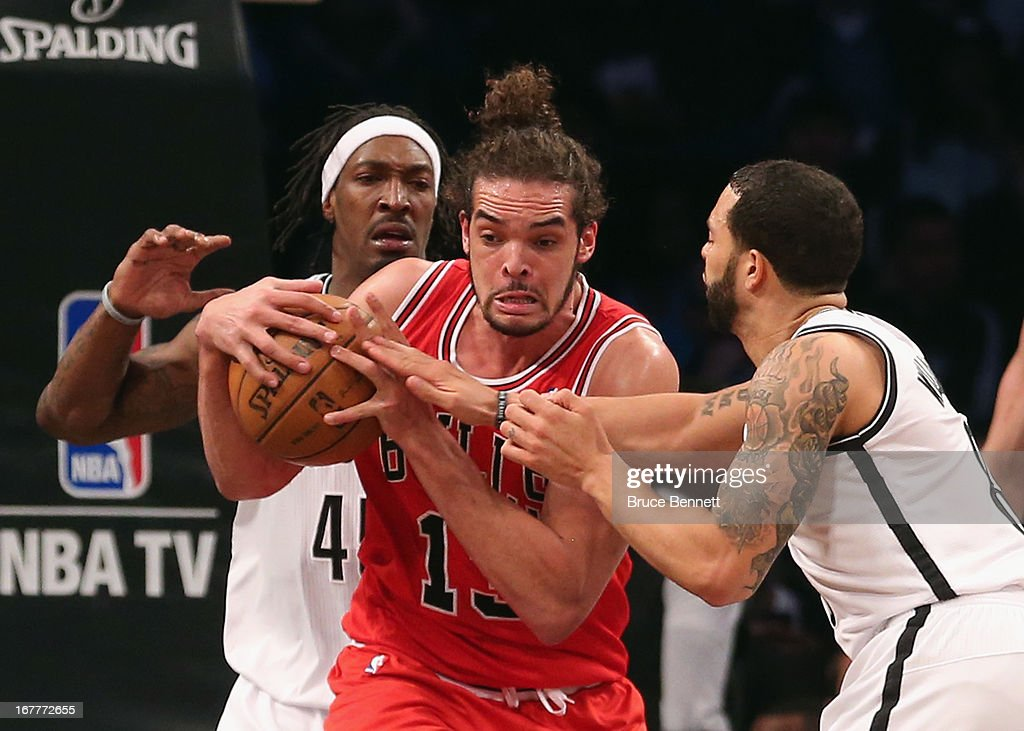 Gerald Wallace #45 and Deron Williams #8 of the Brooklyn Nets attempt to get the ball from Joakim Noah #13 of the Chicago Bulls during Game Five of the Eastern Conference Quarterfinals of the 2013 NBA Playoffs at the Barclays Center on April 29, 2013 in New York City. The Nets defeated the Bulls 110-91.