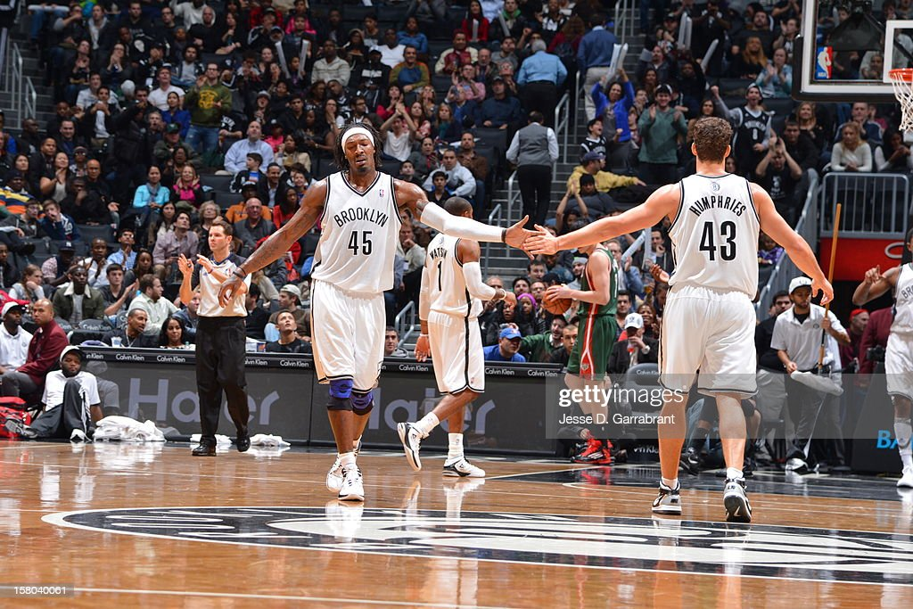 Gerald Wallace #45 and Kris Humphries #43 of the Brooklyn Nets celebrate during the game against the Milwaukee Bucks at the Barclays Center on December 9, 2012 in Brooklyn, New York.