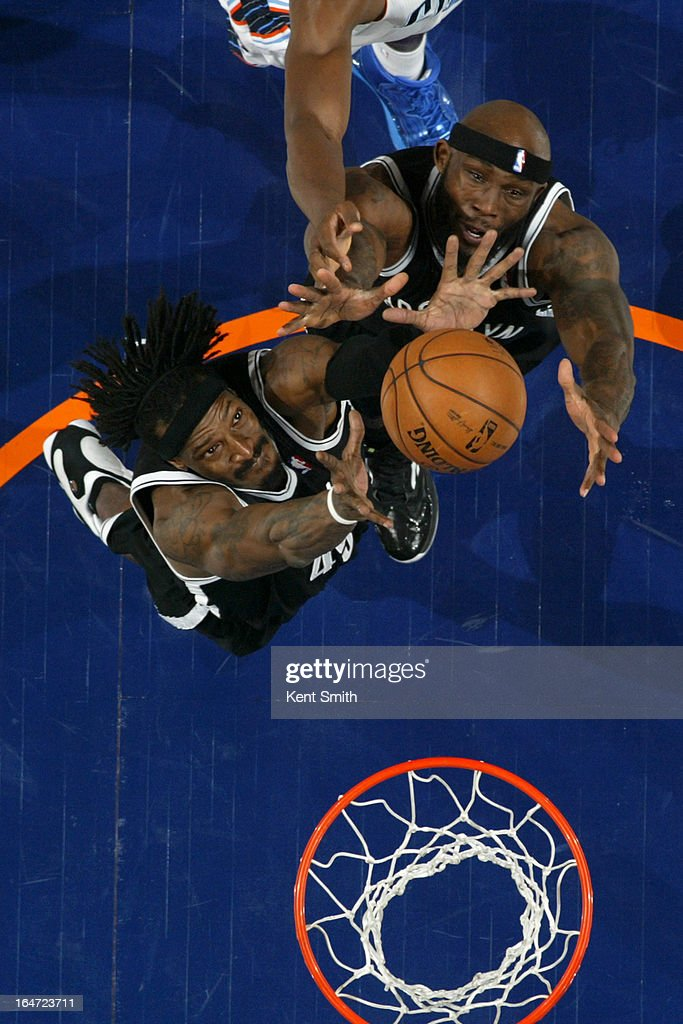 <a gi-track='captionPersonalityLinkClicked' href=/galleries/search?phrase=Gerald+Wallace&family=editorial&specificpeople=202117 ng-click='$event.stopPropagation()'>Gerald Wallace</a> #45 and <a gi-track='captionPersonalityLinkClicked' href=/galleries/search?phrase=Reggie+Evans&family=editorial&specificpeople=202254 ng-click='$event.stopPropagation()'>Reggie Evans</a> #30 of the Brooklyn Nets rebounds against the Charlotte Bobcats at the Time Warner Cable Arena on March 6, 2013 in Charlotte, North Carolina.
