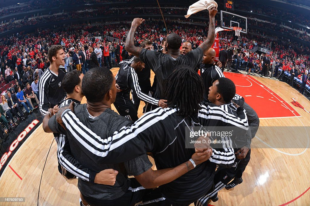 <a gi-track='captionPersonalityLinkClicked' href=/galleries/search?phrase=Gerald+Wallace&family=editorial&specificpeople=202117 ng-click='$event.stopPropagation()'>Gerald Wallace</a> #45 and the Brooklyn Nets huddle up before the game against the Chicago Bulls in Game Three of the Eastern Conference Quarterfinals during the 2013 NBA Playoffs on April 25, 2013 at United Center in Chicago, Illinois.