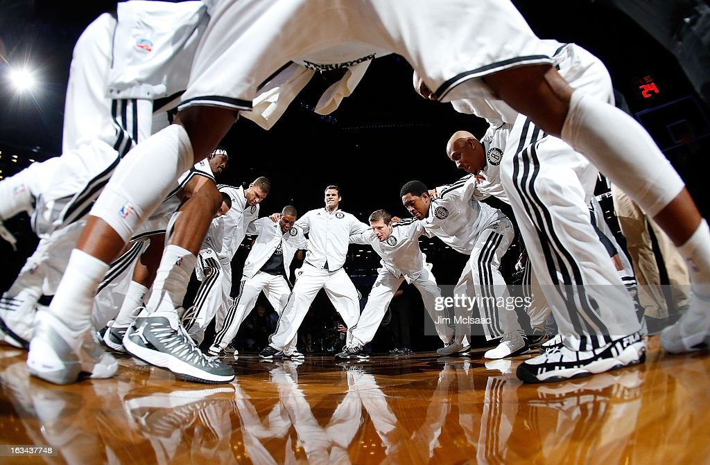 Gerald Wallace #45, Brook Lopez #11, C.J. Watson #1, Kris Humphries #43, Mirza Teletovic #33, MarShon Brooks #9 and Keith Bogans #10 of the Brooklyn Nets prepare to play against the Milwaukee Bucks at Barclays Center on February 19, 2013 in the Brooklyn borough of New York City.The Nets defeated the Bucks 113-111 in overtime.