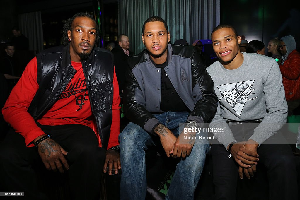 Gerald Wallace, Carmelo Anthony and Russell Westbrook attend the Dare To Fly AJXX8 event at PH-D Rooftop Lounge at Dream Downtown on December 3, 2012 in New York City.