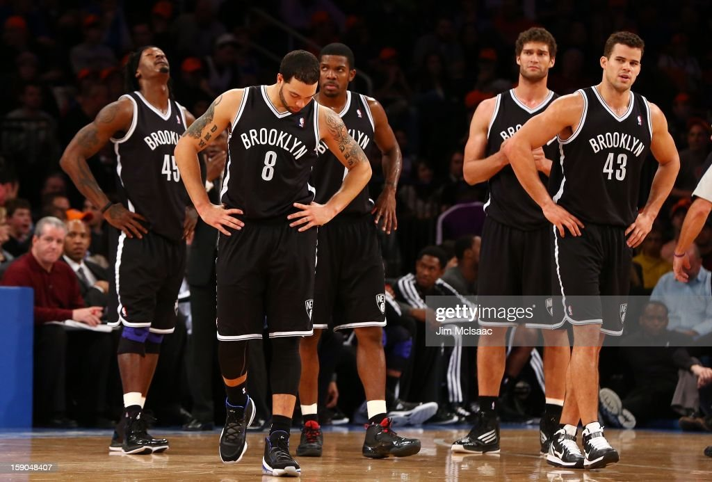 Gerald Wallace #45, Deron Williams #8, Joe Johnson #7, Brook Lopez #11 and Kris Humphries #43 of the Brooklyn Nets look on against the New York Knicks at Madison Square Garden on December 19, 2012 in New York City. The Knicks defeated the Nets 100-86.