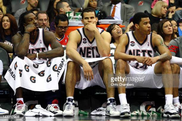 Gerald Wallace Kris Humphries and Gerald Green of the New Jersey Nets look on from the bench in the closing minutes of their 10587 loss to the...