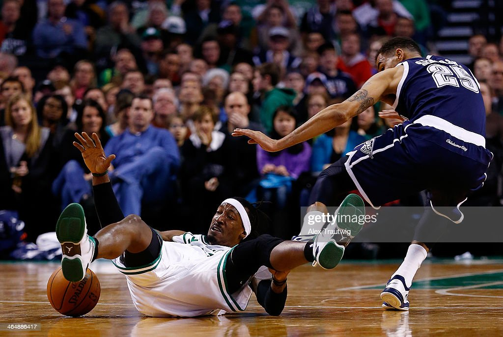 Gerald Wallace #45 of the Boston Celtics and Thabo Sefolosha #25 of the Oklahoma City Thunder battle for a loose ball during a game at the TD Garden on January 24, 2014 in Boston, Massachusetts.