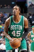 Gerald Wallace of the Boston Celtics attempts a free throw shot against the Charlotte Hornets on March 30 2015 at Time Warner Cable Arena in...