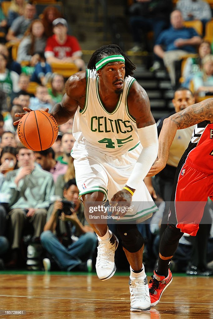 Gerald Wallace #45 of the Boston Celtics brings the ball up court against the Toronto Raptors on October 7, 2013 at the TD Garden in Boston, Massachusetts.