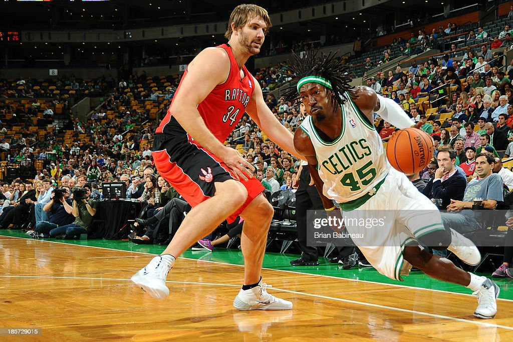 <a gi-track='captionPersonalityLinkClicked' href=/galleries/search?phrase=Gerald+Wallace&family=editorial&specificpeople=202117 ng-click='$event.stopPropagation()'>Gerald Wallace</a> #45 of the Boston Celtics drives to the basket against the Toronto Raptors on October 7, 2013 at the TD Garden in Boston, Massachusetts.