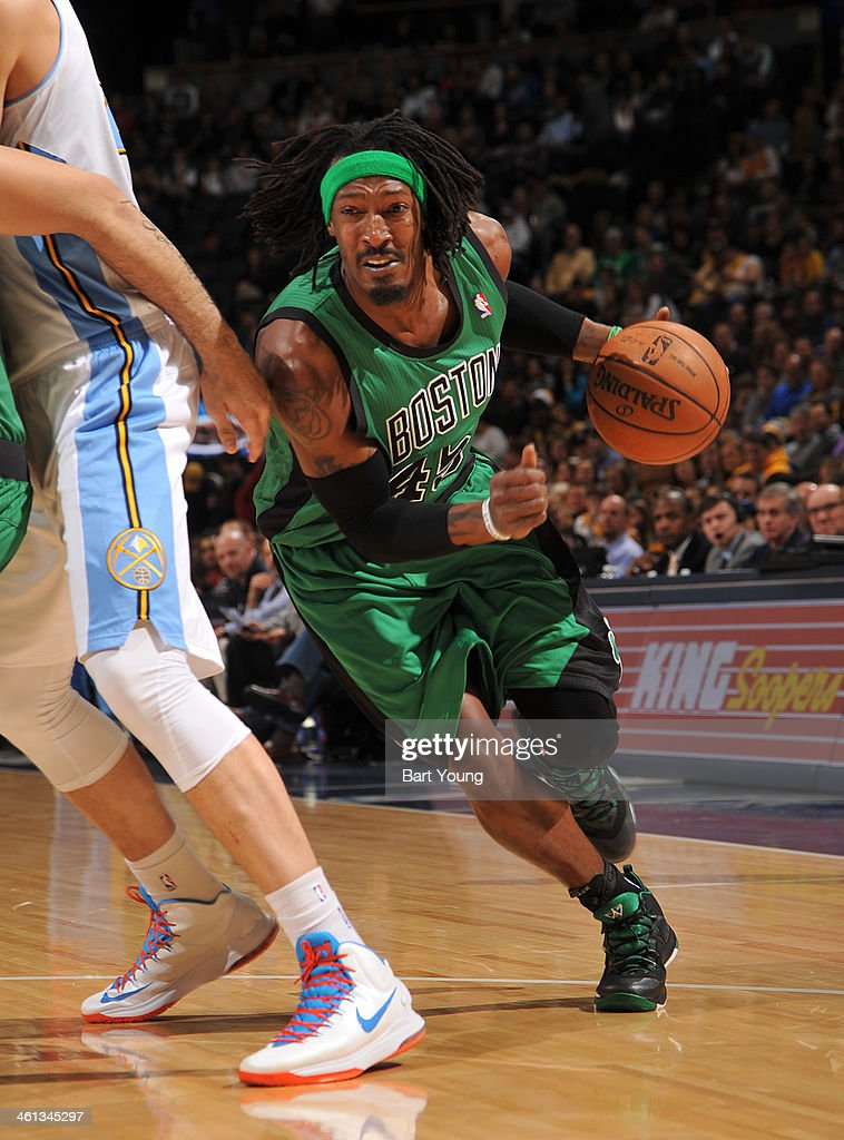 Gerald Wallace #45 of the Boston Celtics drives to the basket against the Denver Nuggets on January 7, 2014 at the Pepsi Center in Denver, Colorado.