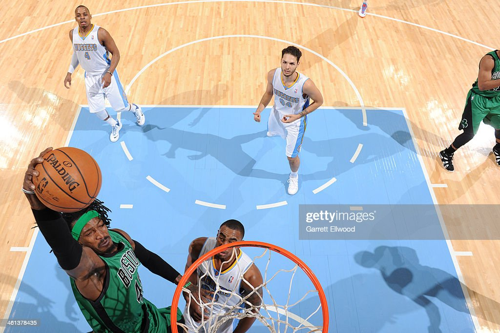 <a gi-track='captionPersonalityLinkClicked' href=/galleries/search?phrase=Gerald+Wallace&family=editorial&specificpeople=202117 ng-click='$event.stopPropagation()'>Gerald Wallace</a> #45 of the Boston Celtics drives to the basket against the Denver Nuggets on January 7, 2014 at the Pepsi Center in Denver, Colorado.