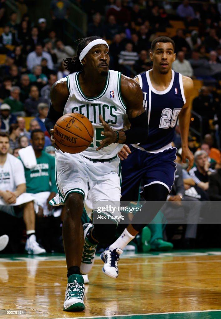 Gerald Wallace #45 of the Boston Celtics drives to the basket as Thabo Sefolosha #25 of the Oklahoma City Thunder defends during a game at the TD Garden on January 24, 2014 in Boston, Massachusetts.