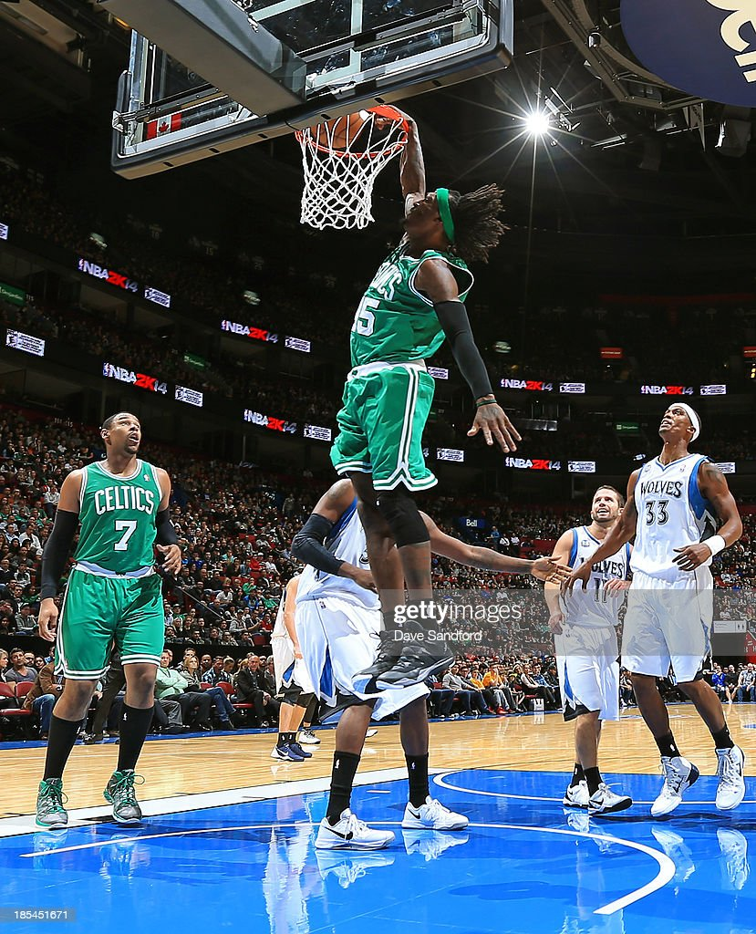<a gi-track='captionPersonalityLinkClicked' href=/galleries/search?phrase=Gerald+Wallace&family=editorial&specificpeople=202117 ng-click='$event.stopPropagation()'>Gerald Wallace</a> #45 of the Boston Celtics dunks the ball as teammate <a gi-track='captionPersonalityLinkClicked' href=/galleries/search?phrase=Jared+Sullinger&family=editorial&specificpeople=6866665 ng-click='$event.stopPropagation()'>Jared Sullinger</a> #7 of the Boston Celtics looks on along with <a gi-track='captionPersonalityLinkClicked' href=/galleries/search?phrase=Dante+Cunningham&family=editorial&specificpeople=683729 ng-click='$event.stopPropagation()'>Dante Cunningham</a> #33 of the Minnesota Timberwolves and J.J. Barea #11 of the Minnesota Timberwolves during their NBA pre-season game at the Bell Centre on October 20, 2013 in Montreal, Quebec, Canada.
