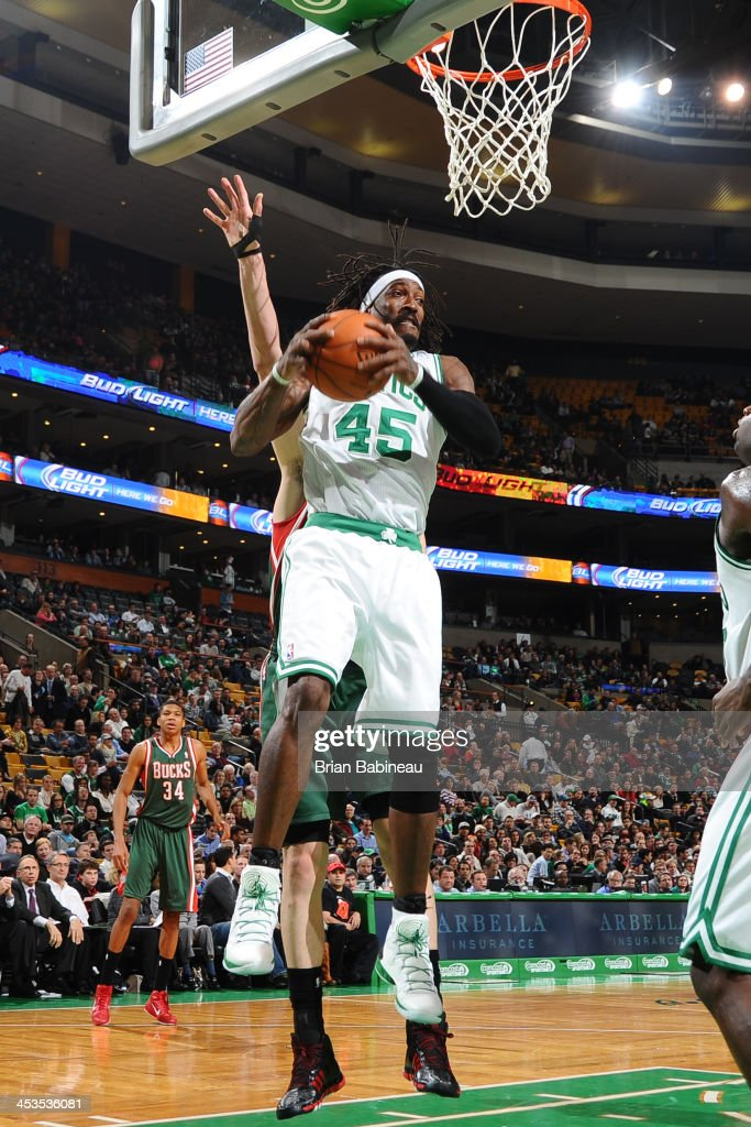 Gerald Wallace #45 of the Boston Celtics grabs the rebound against the Milwaukee Bucks on December 3, 2013 at the TD Garden in Boston, Massachusetts.