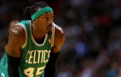 Gerald Wallace of the Boston Celtics looks on during a game against the Miami Heat at AmericanAirlines Arena on January 21 2014 in Miami Florida NOTE...