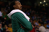 Gerald Wallace of the Boston Celtics looks on from the bench during the fourth quarter against the Milwaukee Bucks at TD Garden on April 3 2015 in...