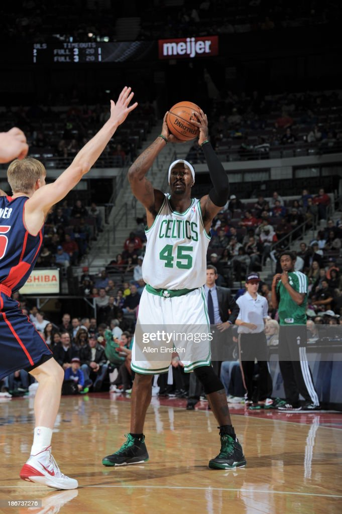 <a gi-track='captionPersonalityLinkClicked' href=/galleries/search?phrase=Gerald+Wallace&family=editorial&specificpeople=202117 ng-click='$event.stopPropagation()'>Gerald Wallace</a> #45 of the Boston Celtics looks to pass the ball against <a gi-track='captionPersonalityLinkClicked' href=/galleries/search?phrase=Kyle+Singler&family=editorial&specificpeople=4216029 ng-click='$event.stopPropagation()'>Kyle Singler</a> #25 of the Detroit Pistons on November 3, 2013 at The Palace of Auburn Hills in Auburn Hills, Michigan.