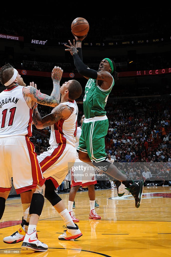 Gerald Wallace #45 of the Boston Celtics shoots against the Miami Heat at the American Airlines Arena in Miami, Florida on January 21, 2014.