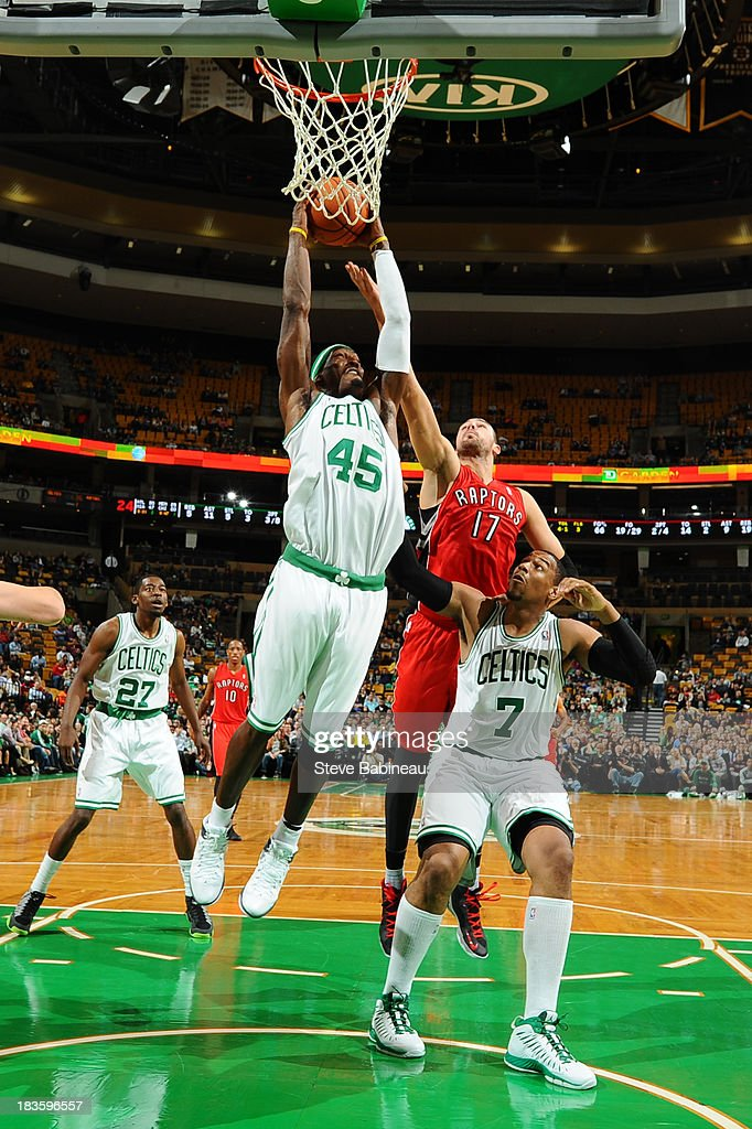 Gerald Wallace #45 of the Boston Celtics shoots the ball against Jonas Valanciunas #17 of the Toronto Raptors on October 7, 2013 at the TD Garden in Boston, Massachusetts.