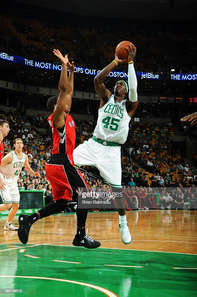 <a gi-track='captionPersonalityLinkClicked' href=/galleries/search?phrase=Gerald+Wallace&family=editorial&specificpeople=202117 ng-click='$event.stopPropagation()'>Gerald Wallace</a> #45 of the Boston Celtics shoots the ball against the Toronto Raptors on October 7, 2013 at the TD Garden in Boston, Massachusetts.
