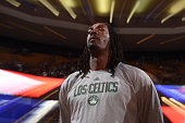 Gerald Wallace of the Boston Celtics stands for the national anthem before a game against the Utah Jazz on March 4 2015 at TD Garden in Boston...