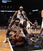 Gerald Wallace of the Brooklyn Nets and Brendan Haywood of the Charlotte Bobcats wrestle for the ball during the second quarter at the Barclays...