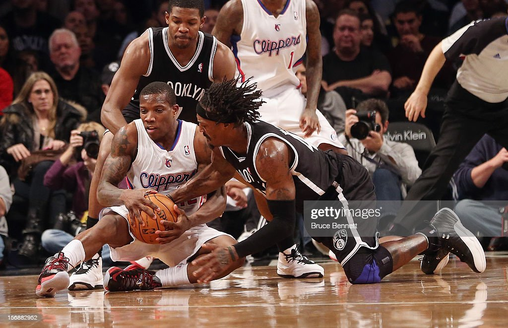 Gerald Wallace #45 of the Brooklyn Nets and Eric Bledsoe #12 of the Los Angeles Clippers battles for the ball in the fourth quarter at the Barclays Center on November 23, 2012 in the Brooklyn borough of New York City.