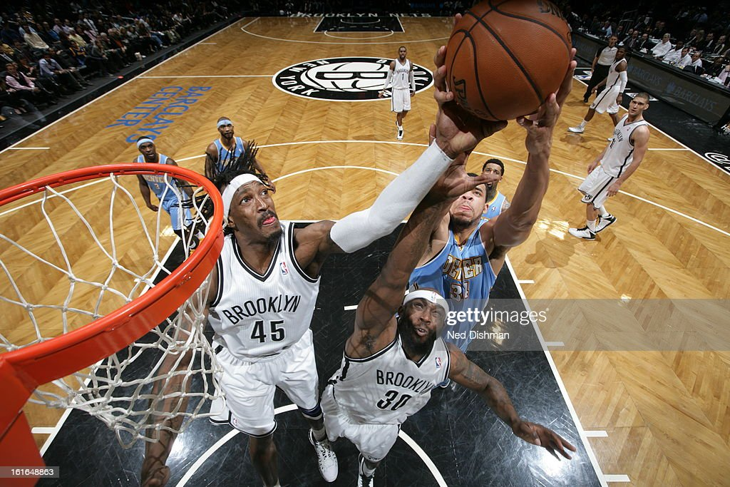 Gerald Wallace #45 of the Brooklyn Nets attempts to grab the ball away from a member of the Denver Nuggets at the Barclays Center on February 13, 2013 in the Brooklyn borough of New York City in New York City.