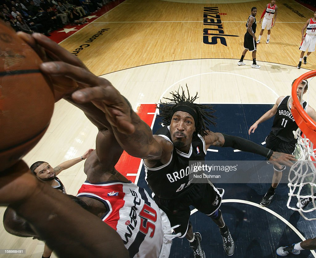 Gerald Wallace #45 of the Brooklyn Nets blocks a shot against Emeka Okafor #50 of the Washington Wizards during the game at the Verizon Center on January 4, 2013 in Washington, DC.