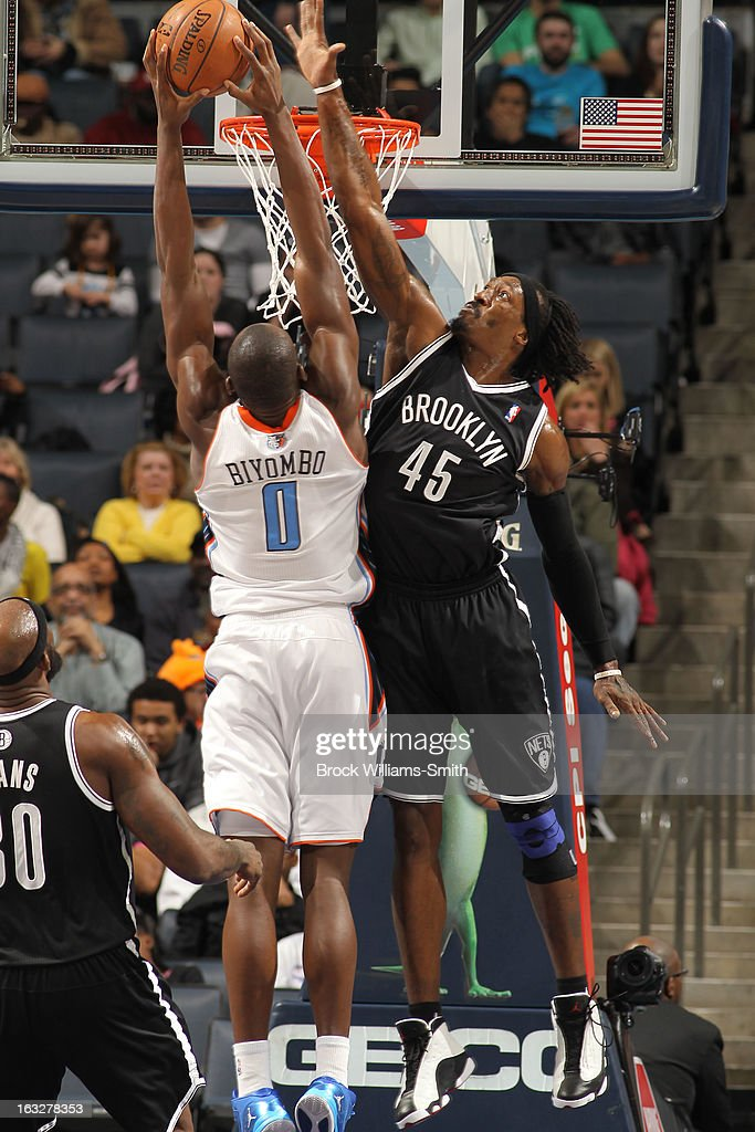 Gerald Wallace #45 of the Brooklyn Nets contests the shot against Bismack Biyombo #0 of the Charlotte Bobcats at the Time Warner Cable Arena on March 6, 2013 in Charlotte, North Carolina.