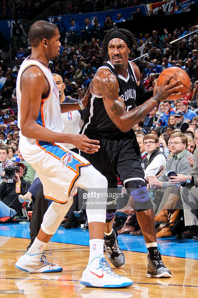 Gerald Wallace #45 of the Brooklyn Nets controls the ball against Kevin Durant #35 of the Oklahoma City Thunder on January 2, 2013 at the Chesapeake Energy Arena in Oklahoma City, Oklahoma.