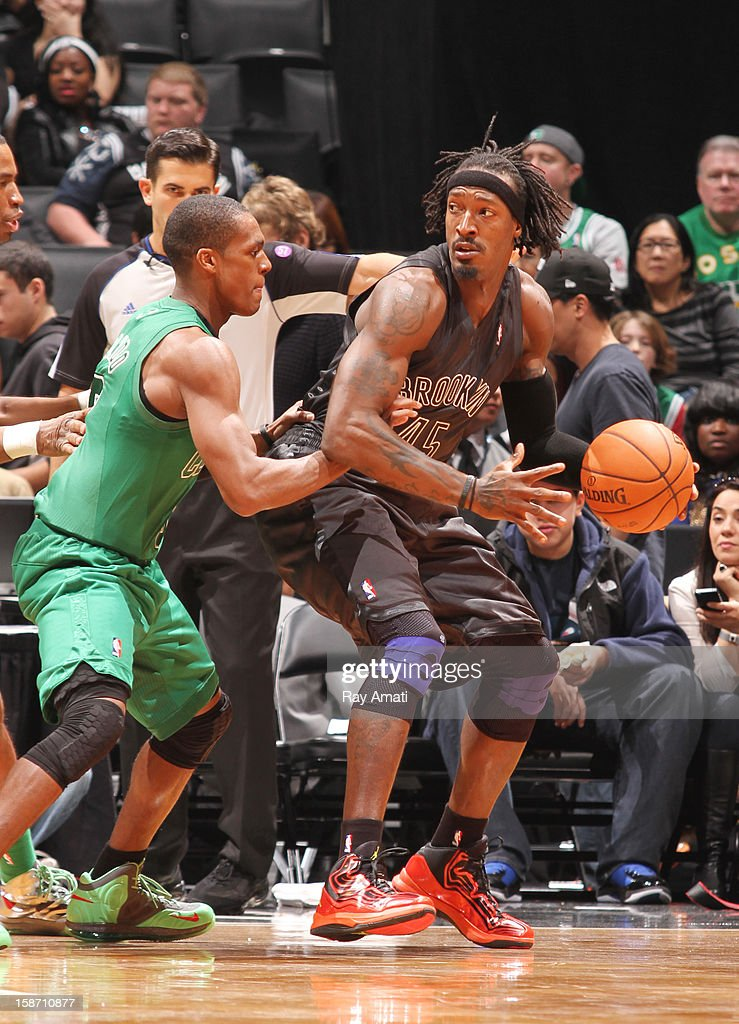 Gerald Wallace #45 of the Brooklyn Nets controls the ball against Rajon Rondo #9 of the Boston Celtics on December 25, 2012 at the Barclays Center in Brooklyn, New York.